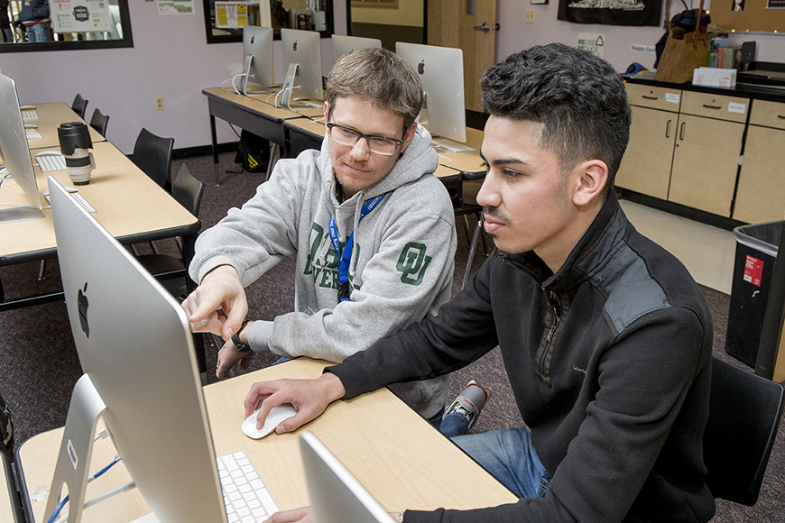 two male students using a computer